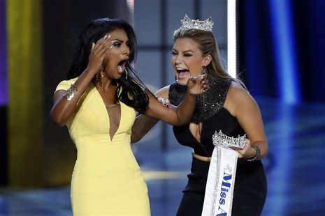 Miss America contestant, Miss New York Nina Davuluri (L) reacts with 2013 Miss America Mallory Hagan after being chosen winner of the 2014 M