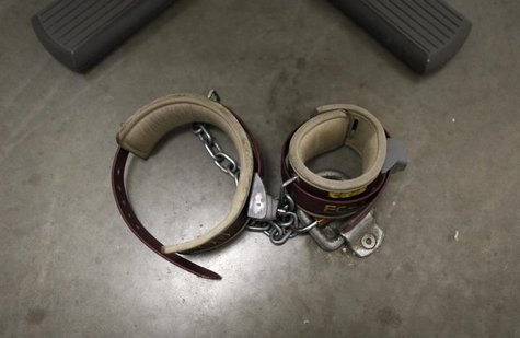 An ankle shackle used by prisoners during meetings with their lawyers is seen on the floor of the conference room at Camp VI, a prison used