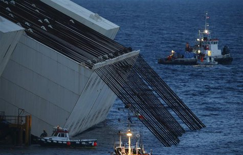 Cables used for the parbuckling of the capsized cruise liner Costa Concordia are seen during the preparation of the operation outside Giglio