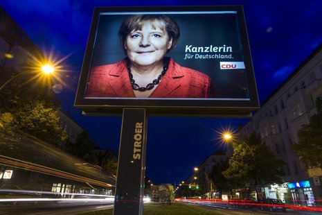 A long exposure photograph shows an election campaign poster of German Chancellor and conservative Christian Democratic Union (CDU) leader A