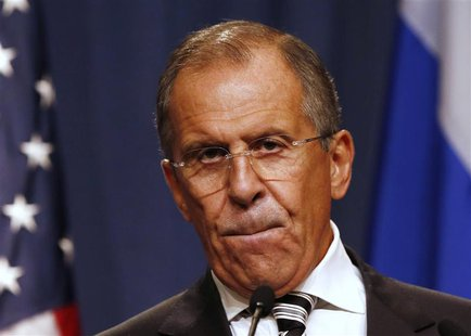 Russian Foreign Minister Sergei Lavrov pauses at a news conference, following meetings regarding Syria with U.S. Secretary of State John Ker