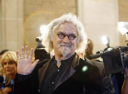 "Cast member Billy Connolly waves at the premiere of ""Fido"" at the Ryerson theatre during the 31st Toronto International Film Festival in Tor"