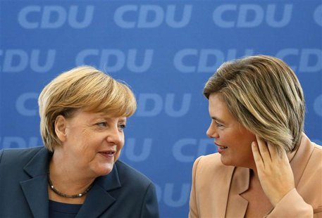 German Chancellor Angela Merkel and leader of the Christian Democratic Union party (CDU) chats with Julia Kloeckner (R) from the CDU of the