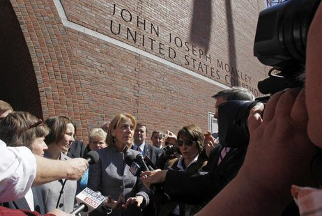 Massachusetts Attorney General Martha Coakley (C) speaks to reporters outside the U.S. District Court after attending a hearing before a fed