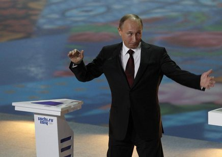 Russian President Vladimir Putin gestures during a ceremony to launch a countdown clock for the 2014 Winter Olympics in the Bolshoi Ice Dome