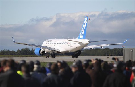 Bombardier employees and guests watch the CSeries aircraft taxi on the runway for its first test flight in Mirabel, Quebec, September 16, 20