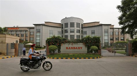 A man rides a motorcycle in front of the office of Ranbaxy Laboratories at Gurgaon, on the outskirts of New Delhi in this June 13, 2013 file