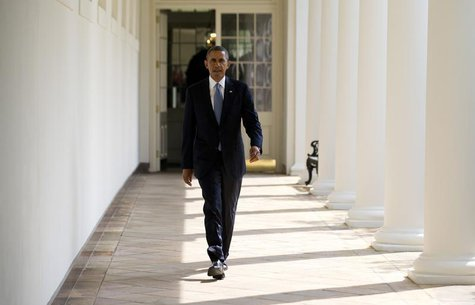 U.S. President Barack Obama walks from his residence to the Oval Office at the White House in Washington, September 10, 2013. REUTERS/Jason