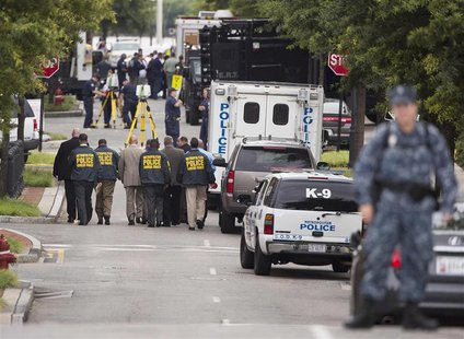 Police walk in the Washington Navy Yard after a shooting in Washington on September 16, 2013. REUTERS/Joshua Roberts