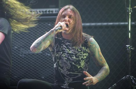 Singer Tim Lambesis of As I Lay Dying performs at the 2nd annual Golden Gods awards in Los Angeles, in this April 8, 2010 file photo. REUTER