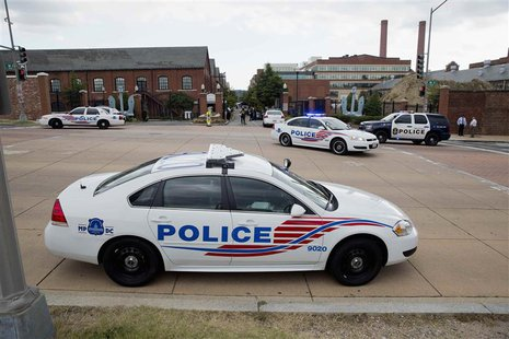 Police cars are parked outside the U.S. Navy Yard after a shooting in Washington September 16, 2013. REUTERS/Joshua Roberts