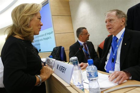 Eileen Donahoe (L) U.S. Ambassador to the Human Rights Council speaks with Michael Kirby, Chairperson of the Commission of Inquiry on Human