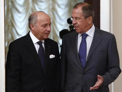 Russia's Foreign Minister Sergei Lavrov (R) meets with his French counterpart Laurent Fabius in Moscow September 17, 2013. REUTERS/Maxim She