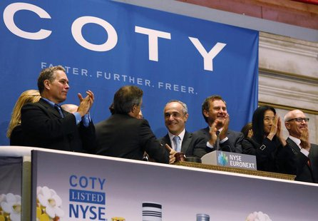 Michele Scannavini, (C) CEO of Coty Inc., and company representatives ring the opening bell at the New York Stock Exchange to celebrate the