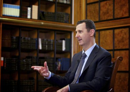 Syria's President Bashar al-Assad speaks during an interview with Russian state television RU24 in Damascus in this September 12, 2013 hando