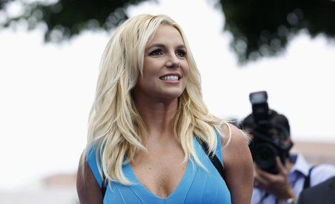 "Singer Britney Spears poses at the premiere of ""The Smurfs 2"" at the Regency Village theatre in Los Angeles, California July 28, 2013. REUTE"