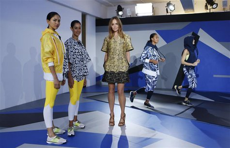 Designer Stella McCartney (C) poses with models wearing creations from the Adidas by Stella McCartney Spring/Summer 2014 collection during L