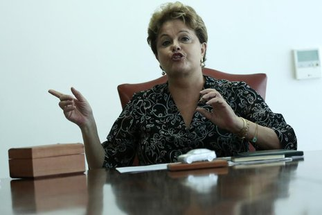 Brazil's President Dilma Rousseff gestures during a meeting with Audi CEO Rupert Stadler at the Planalto Palace in Brasilia September 17, 20