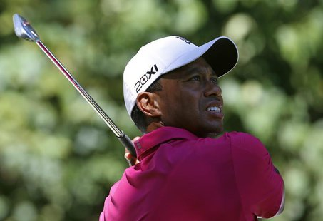 Tiger Woods of the U.S. hits from the second tee during the third round of the BMW Championship golf tournament at the Conway Farms Golf Clu