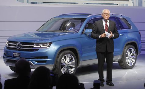 Dr. Ulrich Hackenberg, Member of the Board, Volkswagen Brand, speaks next to the 2014 Touran Cross Blue at the North American International
