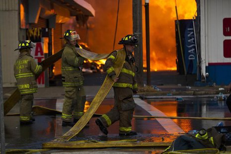 New Jersey firefighters arrive to control a massive fire in Seaside Park in New Jersey September 12, 2013. REUTERS/Eduardo Munoz
