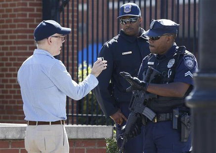 A visitor at the main gate of the Washington Navy Yard is stopped to have his identification checked in Washington, September 17, 2013. REUT