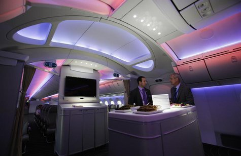 Mark Jenks (R), Boeing's vice president of 787-9 development, speaks to an executive along the archway of the 787 Dreamliner during a demons