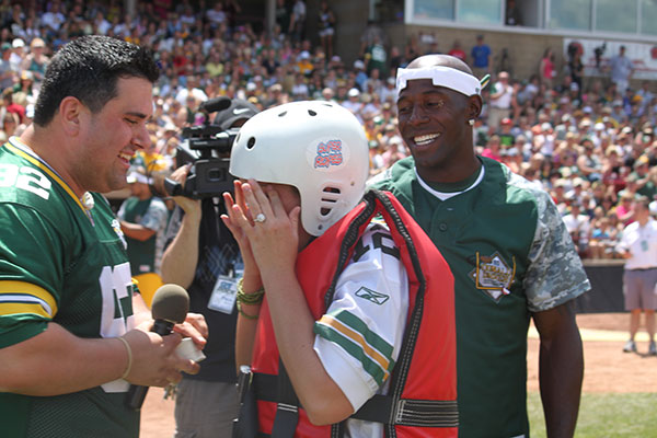On field marriage proposal at Donald Driver Softball Game