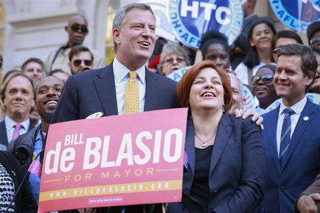 New York City Democratic mayoral nominee Bill de Blasio (L) embraces former mayoral candidate and City Council Speaker Christine Quinn durin