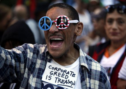 An Occupy Wall Street protester chants slogans along 47th Street in New York September 17, 2013. REUTERS/Joshua Lott
