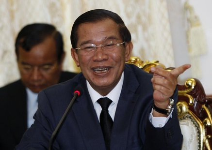 Cambodian Prime Minister Hun Sen smiles during a meeting with Sam Rainsy, president of the Cambodia National Rescue Party (CNRP), at Cambodi