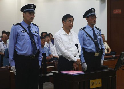 Disgraced Chinese politician Bo Xilai stands trial inside the court in Jinan, Shandong province August 22, 2013, in this photo released by J