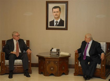 Syrian Foreign Minister Walid al-Muallem (R) meets Russian deputy Foreign Minister, Sergei Ryabkov,in Damascus,in this handout photograph di