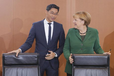 German Chancellor Angela Merkel and Economy Minister Philipp Roesler arrive for the weekly cabinet meeting in Berlin, September 18, 2013. RE
