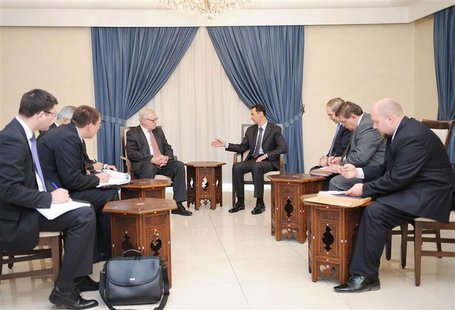 Syria's President Bashar al-Assad (centre, on R) meets Russian deputy Foreign Minister Sergei Ryabkov (centre, on L) in Damascus, in this ha