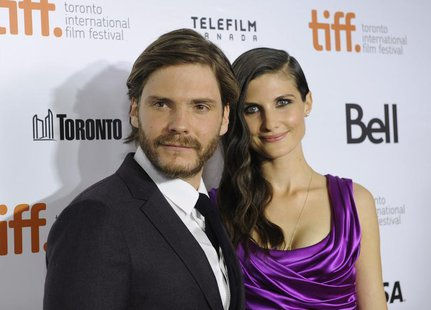 "Cast member Daniel Bruehl poses on the red carpet with girlfriend Felicitas Rombold before a screening of the film ""Rush"" at Roy Thomson Hal"