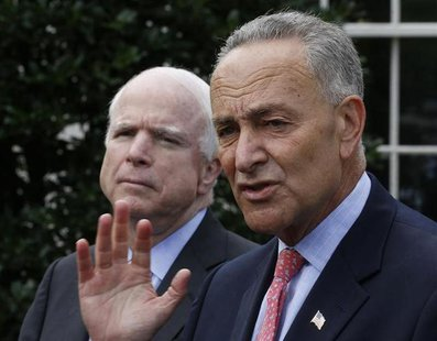 U.S. Senators Charles Schumer (D-NY), R, and John McCain (R-AZ) speak to the media after meeting with U.S. President Barack Obama about immi