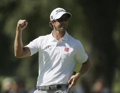 Australia's Adam Scott reacts after his birdie on the first hole during the third round of the 2013 PGA Championship golf tournament at Oak