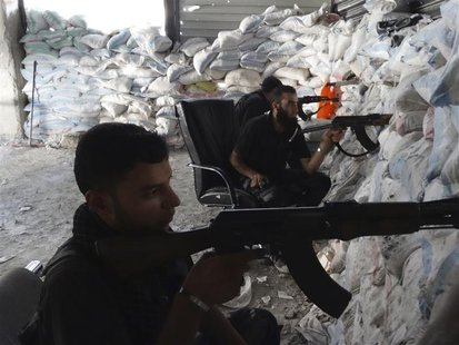 Free Syrian Army fighters take up shooting positions on one of the battlefronts in Jobar, Damascus September 16, 2013. Picture taken Septemb