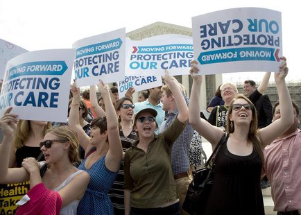Supporters of the Affordable Healthcare Act celebrate in front of the Supreme Court after the court upheld the legality of the law in Washin
