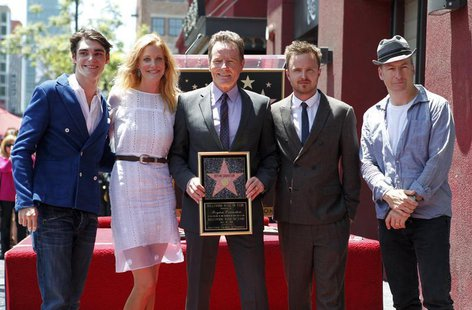 "Actor Bryan Cranston (C) poses with co-stars from his series ""Breaking Bad"" (L-R) RJ Mitte, Anna Gunn, Aaron Paul and Bob Odenkirk during ce"