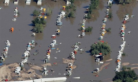 Rows of vehicles lie flooded in Weld County, Colorado September 17, 2013. REUTERS/Rick Wilking