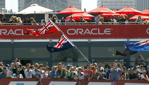 Fans of Emirates Team New Zealand cheer after their team defeated Oracle Team USA during Race 11 of the 34th America's Cup yacht sailing rac