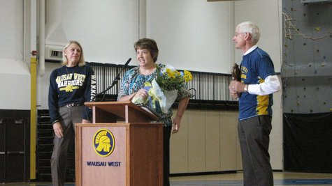 Wausau West teacher Lynn Kohlhepp (center) receives Teacher of the Year award from State Superintendent Tony Evers (right) and Wausau superintendent Kathleen Williams, September 18 2013