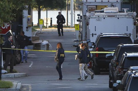 Investigators continue to work the scene at the Navy Yard two days after a gunman killed 12 people before police shot him dead, in Washingto