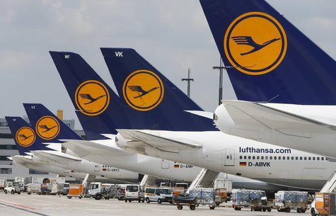 Lufthansa aircrafts sit on the tarmac at Frankfurt airport July 12, 2013. REUTERS/Ralph Orlowski