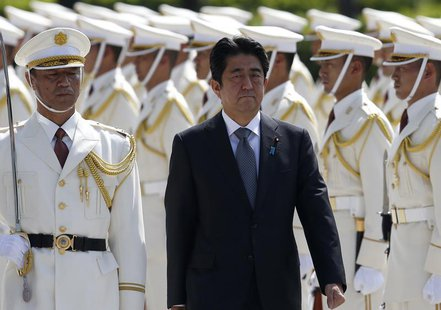 Japan's Prime Minister Shinzo Abe reviews the honour guard before a meeting with Japan Self-Defense Force's senior members at the Defense Mi