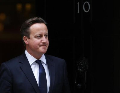 Britain's Prime Minister, David Cameron waits to greet the Prime Minister of New Zealand, John Key, outside 10 Downing Street in central Lon
