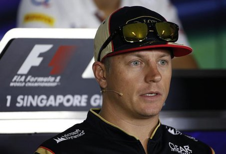 Lotus Formula One driver Kimi Raikkonen of Finland speaks during a news conference ahead of the Singapore F1 Grand Prix September 19, 2013.