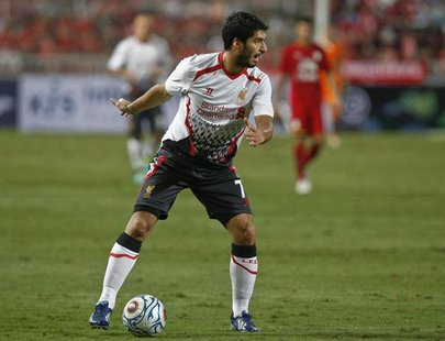 Liverpool's Luis Suarez controls the ball against Thailand's national soccer team during a friendly soccer match at Ratchamangkala Stadium i